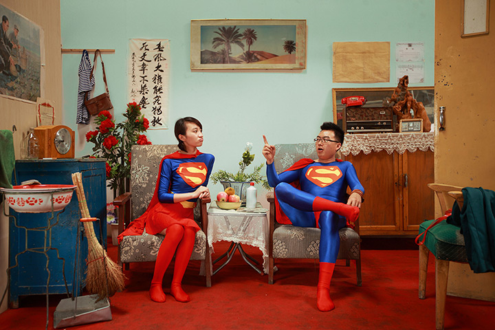 Maleonn's studio mobile: A couple wearing matching Superman outfits