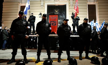 Members of the extreme-right Golden Dawn party stand around a stage during a gathering in Athens