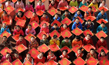 Children with paper-cuts with the Chinese character Ma, meaning Horse