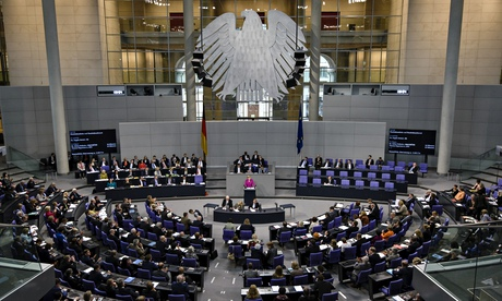 German chancellor Angela Merkel addresses a session of the Bundestag Lower House