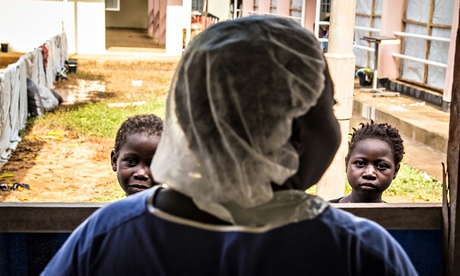 Healthcare worker with children recovering from Ebola, Freetown, Sier