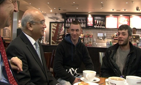 MP Keith Vaz greets arrivals at Luton airport, including Victor Spiresau, right, earlier this year.