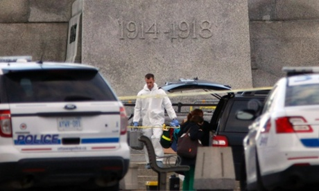 Police at the scene of the shooting at the National Memorial near Parliament Hill in Ottawa, Canada's capital.