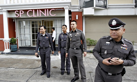 Police close the street after a British woman was found dead at a beauty clinic in Bangkok, Thailand