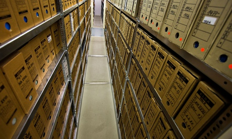 Files lining the shelves in the archives of the former East German secret police, the Stasi. Did the