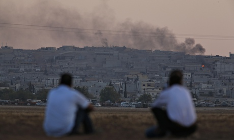 Smoke rising from a fire following an air strike in Kobani, Syria