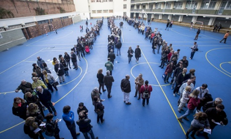 Voters queue to take part in the symbolic Catalan independence referendum.