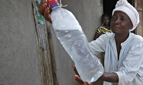 African woman with bottle of drinking water