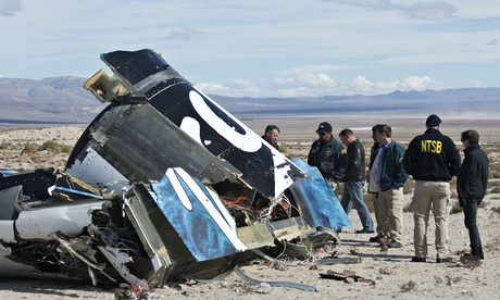 Investigators from the National Transportation Safety Board stand beside the debris of Virgin Galact