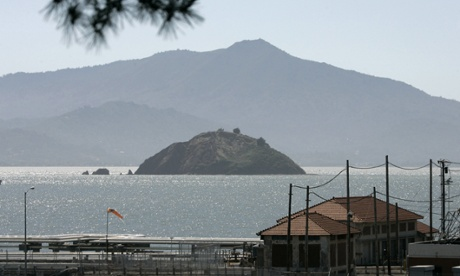 Red Rock Island with Mt. Tamalpais in the background is seen in this view taken from Point Richmond, Calif chevron refinery