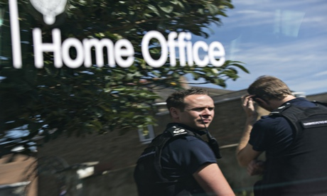 Home Office immigration enforcement officers reflected in their vehicle