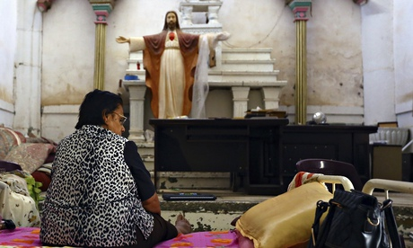 An Iraqi Christian woman sits inside a church in Telkaif near Mosul