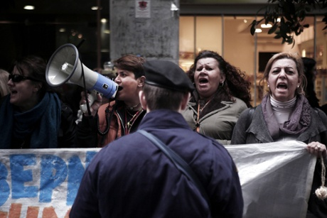 Laid-off members of the cleaning staff at the Finance ministry shout slogans during a protest outside the ministry in Athens during the visit of the so-called troika creditors in Athens on February 24, 2014.