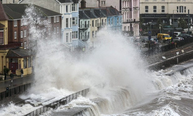 Waves crash against the seafront and the railway line that has been closed due to storm damage at Dawlish in Devon.