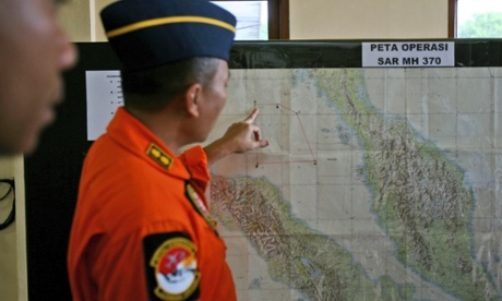 An Indonesia air force officer shows a map of Malacca Straits during a briefing prior to a search operation for the missing Malaysia Airlines Boeing 777.