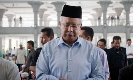 Malaysian Prime Minister Najib Razak prayers for passengers and crew of missing Malaysia Airlines flight MH370 at mosque near Kuala Lumpur International Airport, Malaysia.