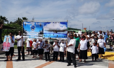 Islanders and descendants from Rongelap Atoll march in Majuro on the 60th anniversary of the nuclear explosion that led to their exile.