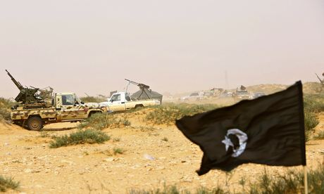Rebels vehicles are deployed to maintain the blockade of oil ports near the city of Sirte, Libya