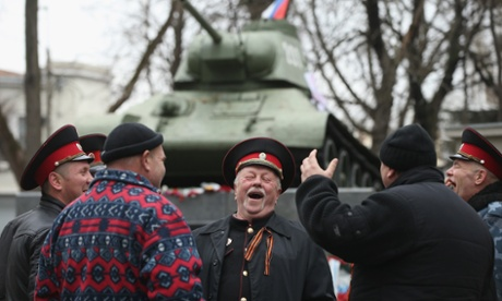 Pro-Russian Cossacks share a laugh next to a war monument in Simferopol.