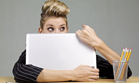 An embarrassed woman after a computer error