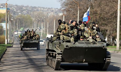 Men wearing military fatigues in the eastern Ukrainian city of Kramatorsk