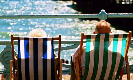 People in deckchairs, Brighton beach
