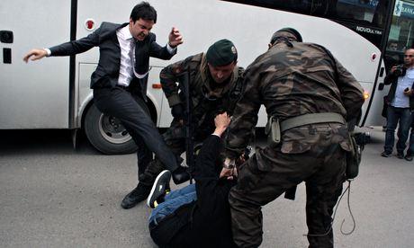 Yusuf Yerkel kicks a protester