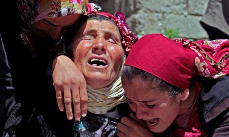 Relatives mourn during the funeral of one of the miners killed in Soma, Turkey