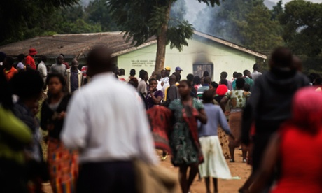 A voting station smoulders after angry voters torched it in the Chiwembe district on 20 May 2014 in Blantyre, Malawi.