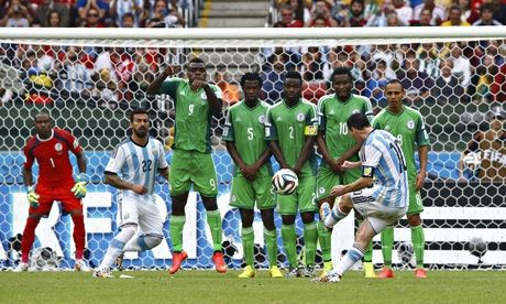 Argentina's Lionel Messi scores his second goal against Nigeria from a free-kick in Group F.