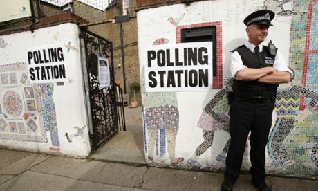 A police officer outside a polling station on Columbia Road in Tower Hamlets