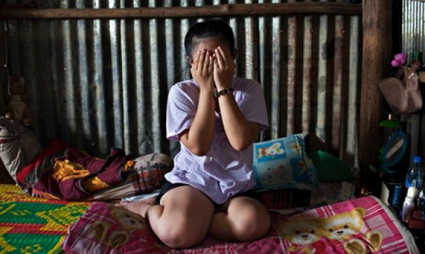 Dara Keo, in the room she rents with her mother and sister in a Phnom Penh slum. Through a broker, her mother sold Dara's virginity when Dara was only 12. Photograph: Will Baxter