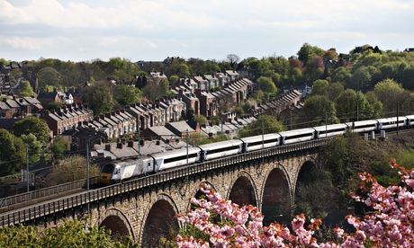 A high-speed diesel train of the East Coast company seen crossing the viaduct at Durham, England, UK