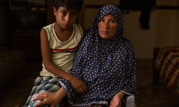 Sawla Bakr and her son Said. Sawla's other son, Mohamed, was killed on Gaza City beach while Said was playing with him