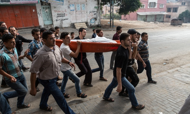 The funeral of Faraj Aiesh, who was a policeman in Gaza for seven years before being killed in an air strike