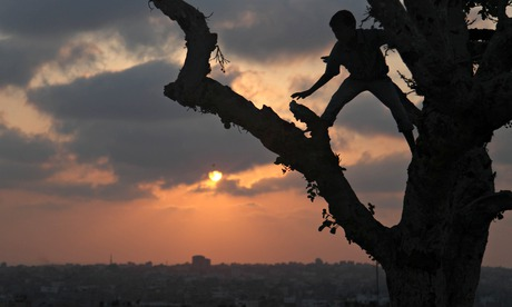 Palestinian boys play Gaza City 18 August 2014