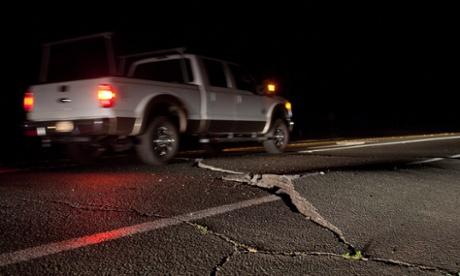 A truck navigates around a buckled section of California's Highway 12. Photograph: Peter DaSilva/EPA