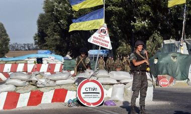 Ukrainian soldiers guard a checkpoint in Mariupol in eastern Ukraine