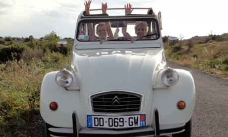 Liz Boulter (on the right) in a Citroen 2CV car in Narbonne, France