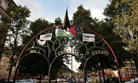 The Isis flag outside the Poplar housing estate, surrounded by a Palestine flag and Gaza placards