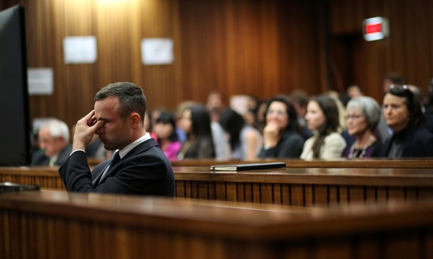 Oscar Pistorius rubs his eye in court in Pretoria, South Africa, 2014.  Pistorius is charged with the murder of his girlfriend Reeva Steenkamp.