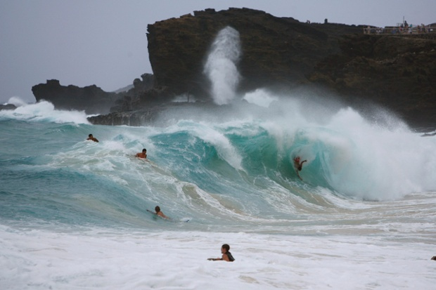 Riding the waves at Sandy beach on the east side of Oahu as Tropical Storm Iselle passes through the Hawaiian islands, in Honolulu, Hawaii.