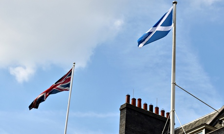 The Scottish flag (R) flutters next to t