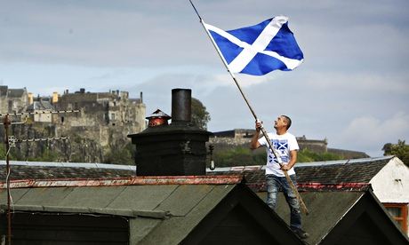 Yes supporter Richard Harrow on the roof of his home in the shadow of Stirling Castle.
