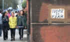 A home-made sign spotted outside the polling station as people arrived to vote in west Glasgow, Scotland.