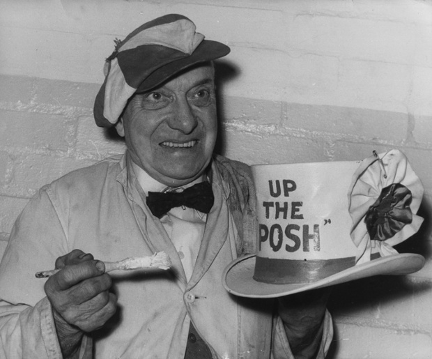 Peterborough United's mascot Dusty Hall, paints his hat with the slogan 'Up The Posh', in preparation for his team's fourth round cup tie against Sheffield United in January 1960.