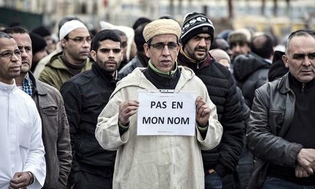 A Muslim man holds a placard reading 'Not in my name', during a gathering in Saint-Etienne, eastern