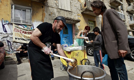 Man receiving food at a soup kitchen in Athens
