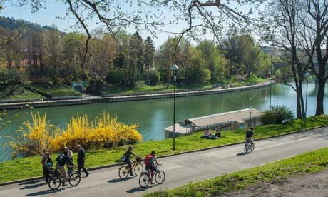 People cycling on the banks of the Po river in northern Italy