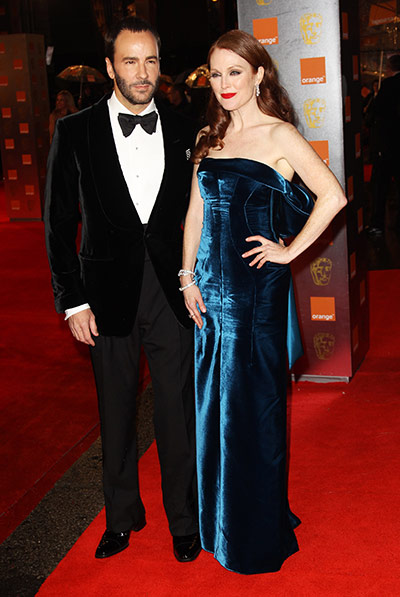 Baftas 2011: fashion: Tom Ford and Julianne Moore arrive at the Baftas
